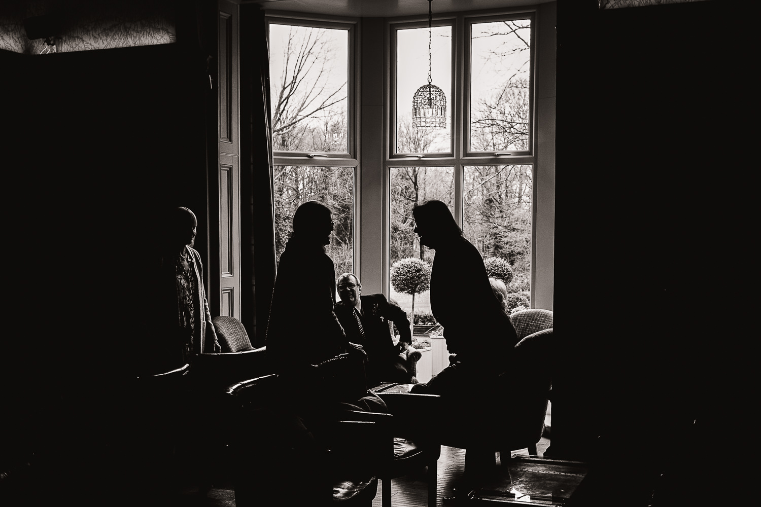 wedding guests sitting by a window