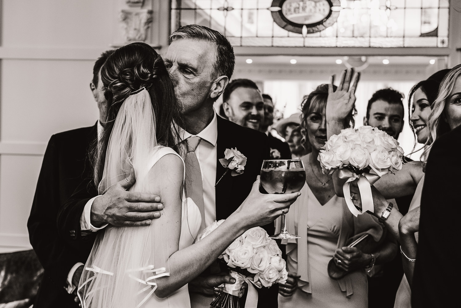 father giving the bride a hug and a kiss