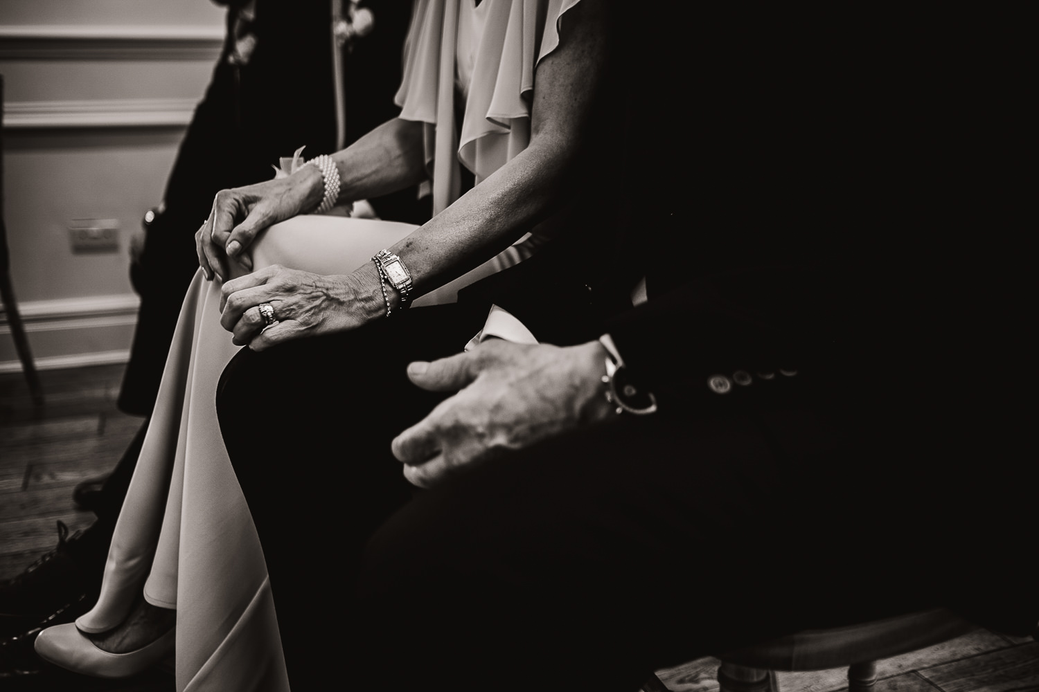 Mother the bride with her hand on her husband leg