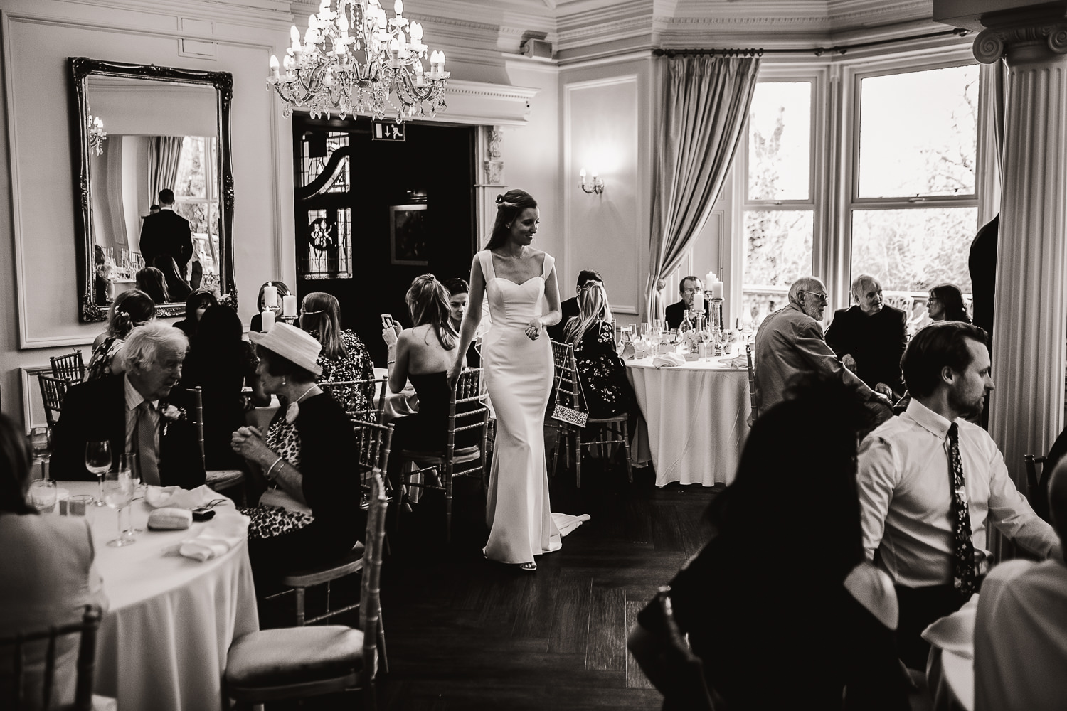 bride stood in the middle of the wedding breakfast