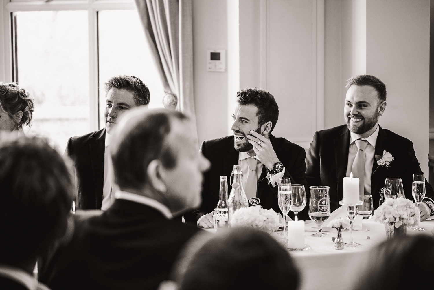 wedding guest laughing during the speeches