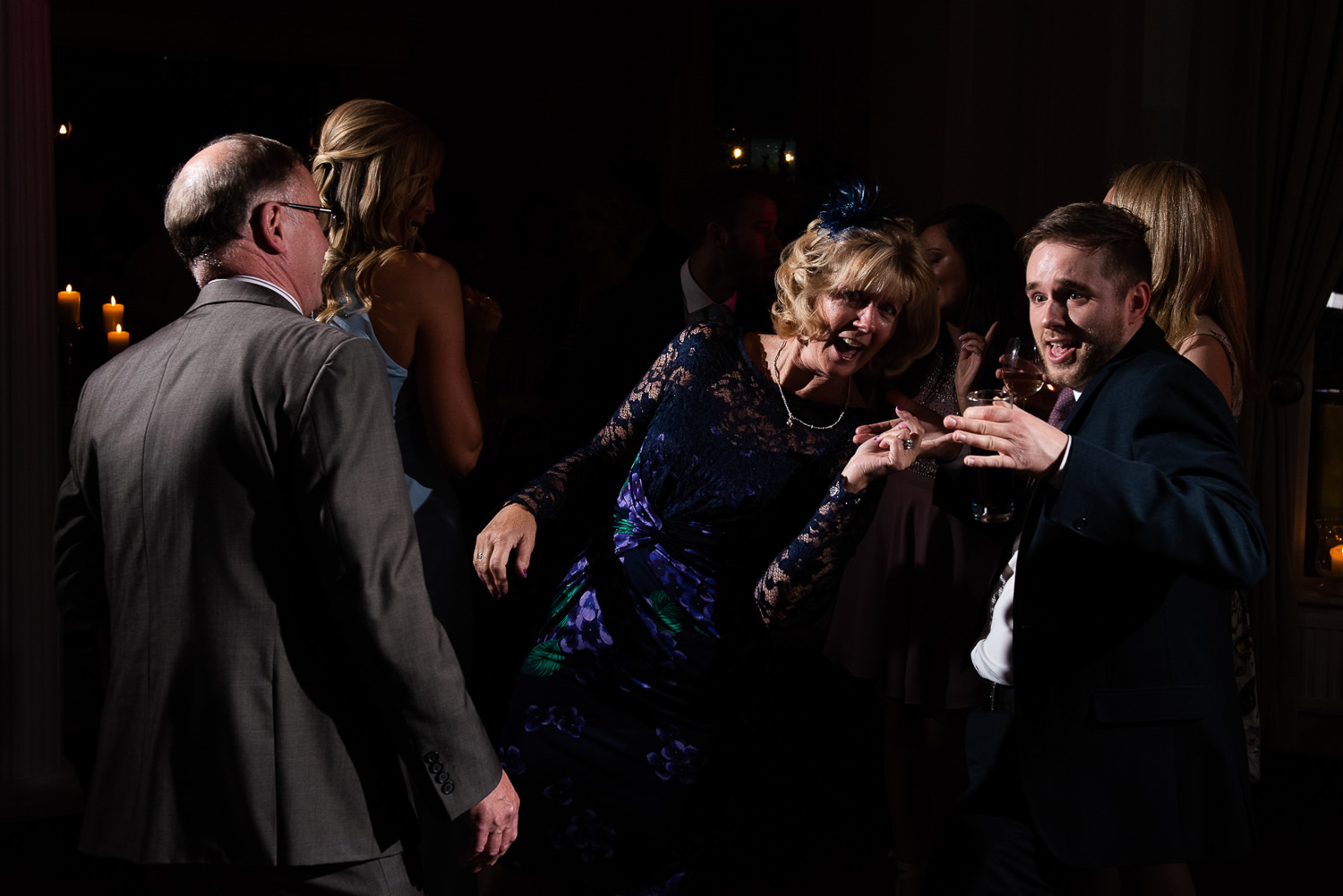 guest parting on the dance floor