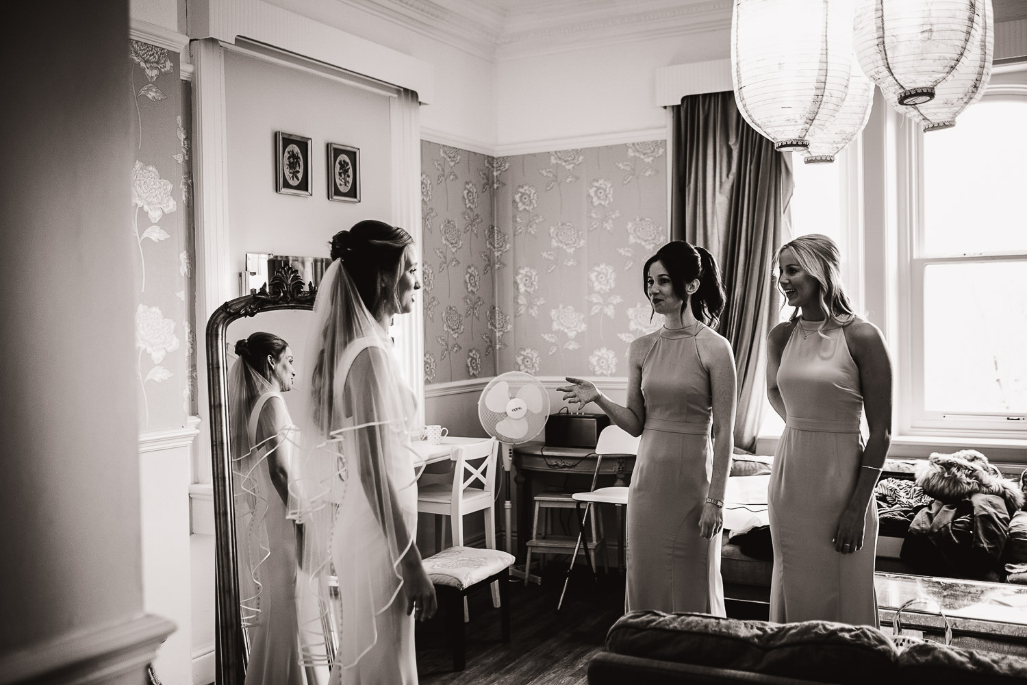 brides and bridesmaids standing in the hotel room moments before the ceremony