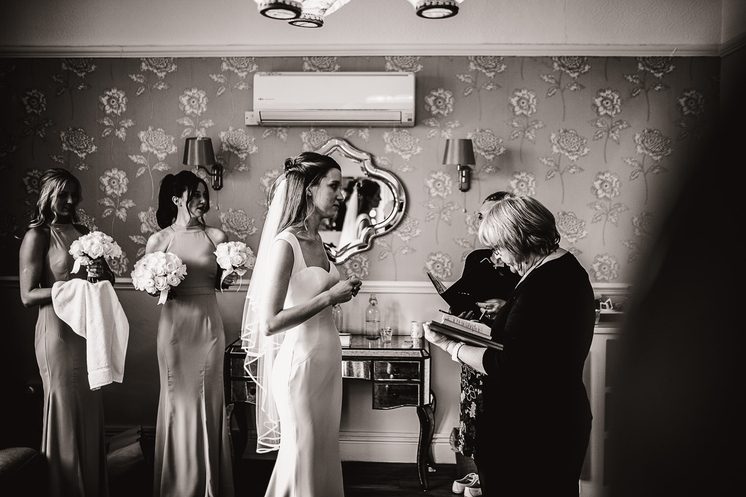 registrar talking to the bride in the hotel room