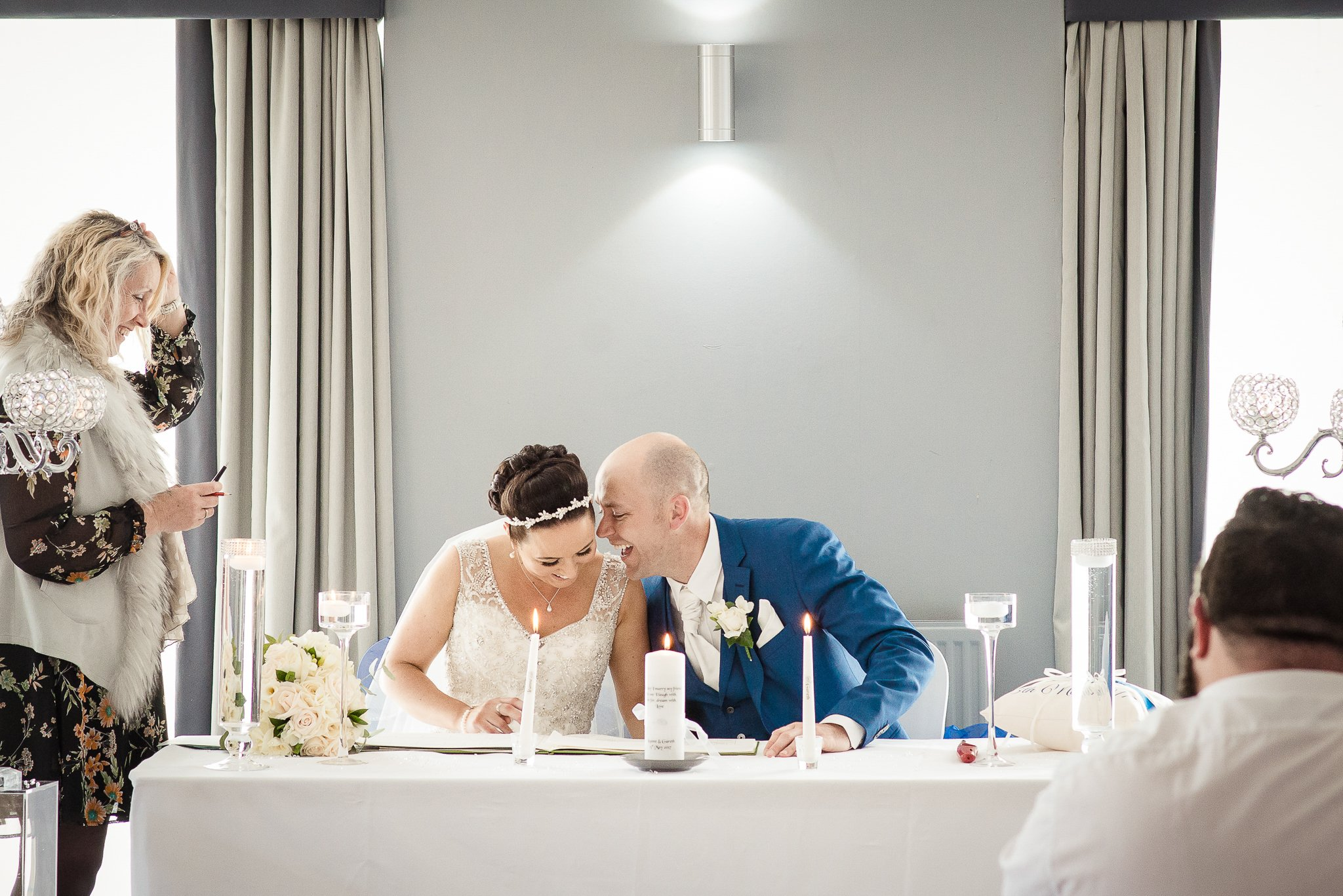 bride and groom singing the register