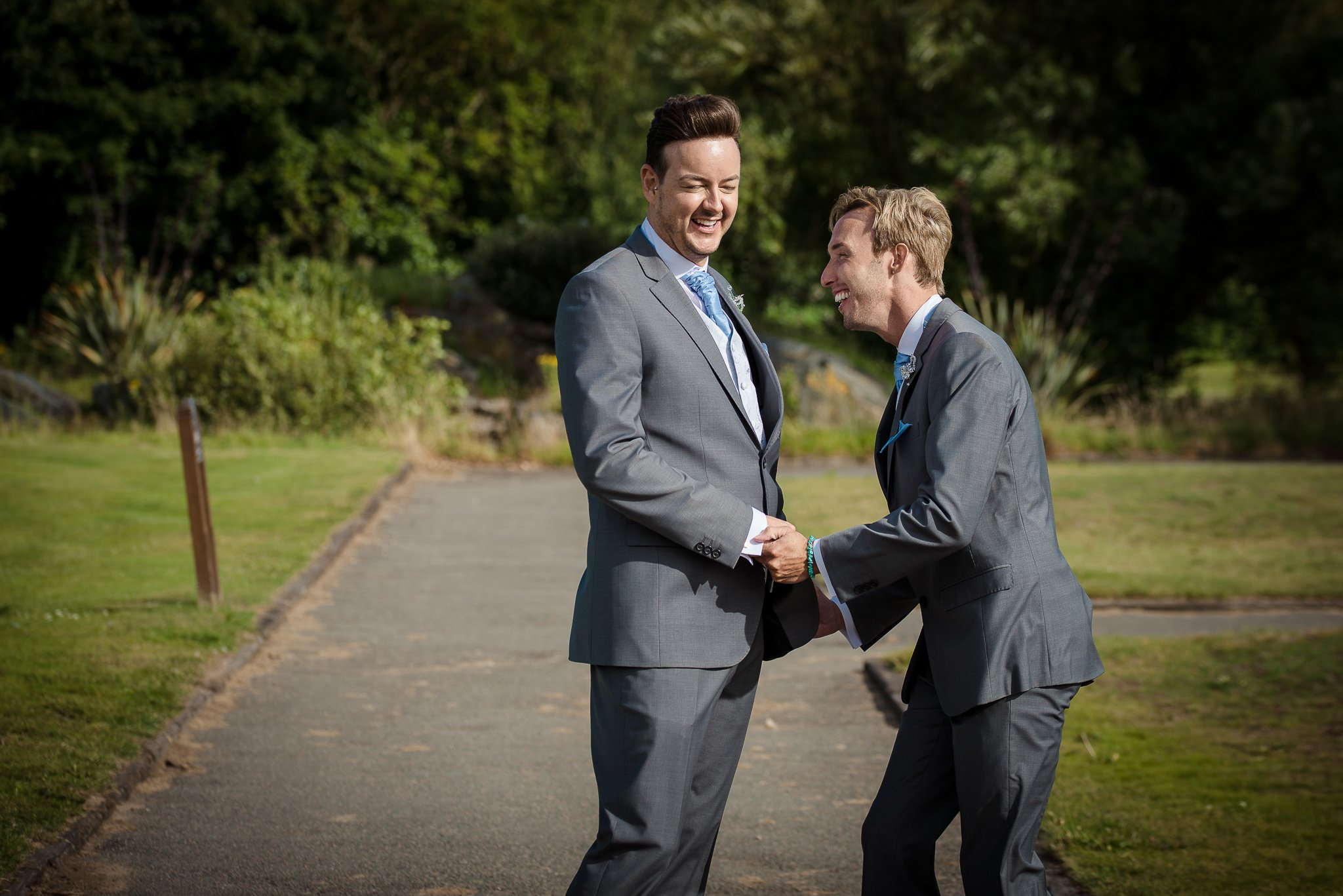 groom and groom holding hands laughing