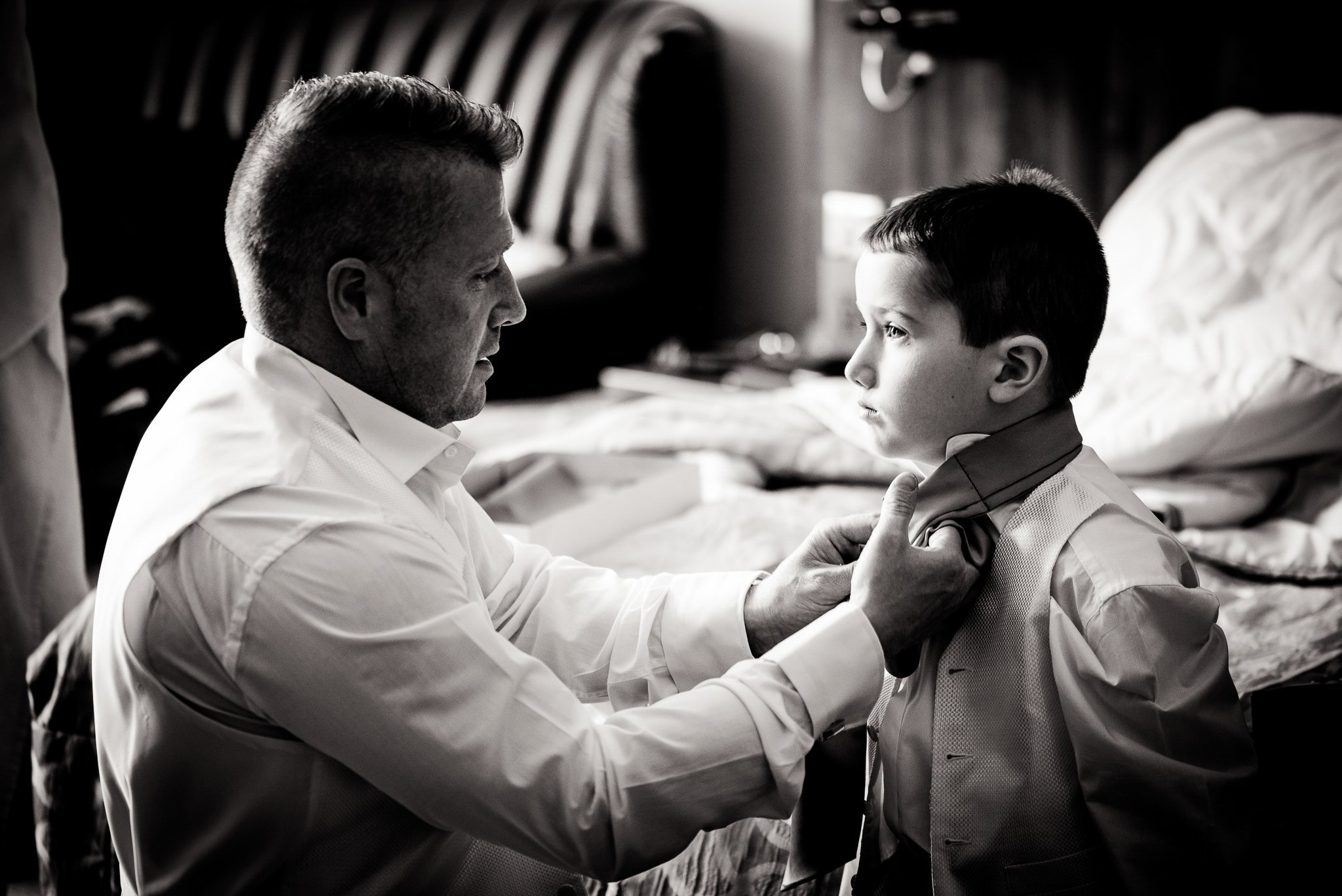 groom helping his son with his bow tie