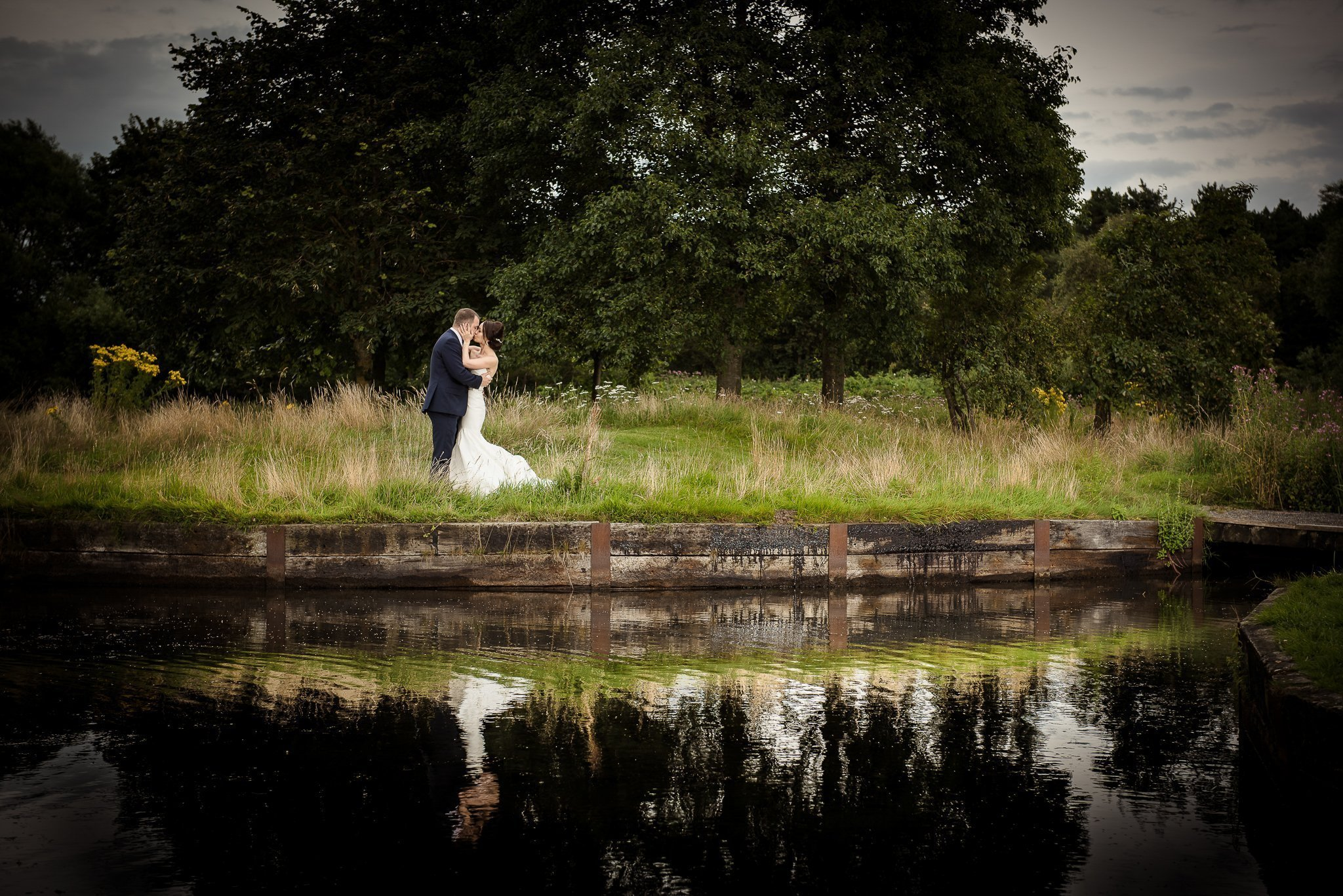 bride and groom water reflection photograph
