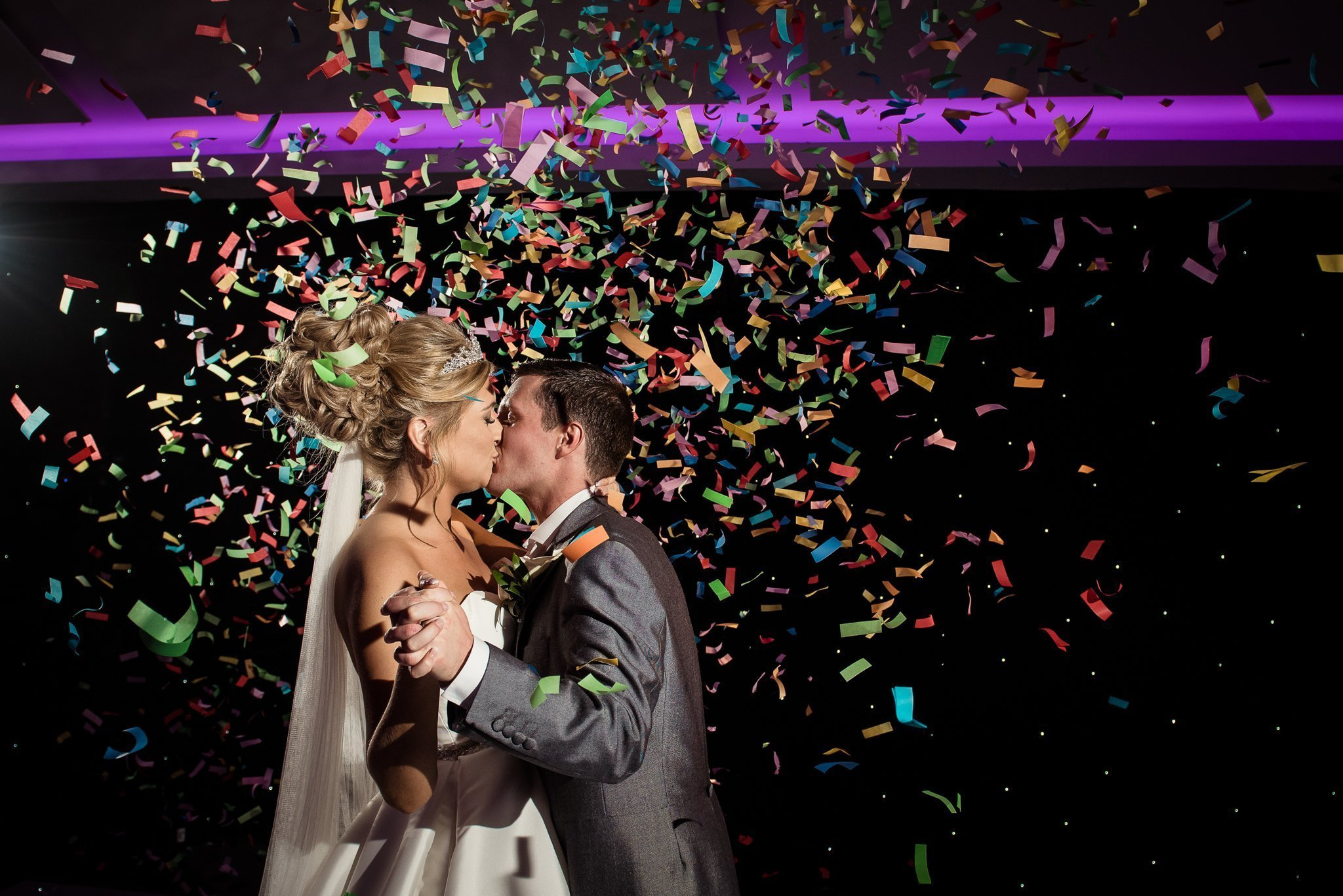 bride and groom confetti cannon during first dance