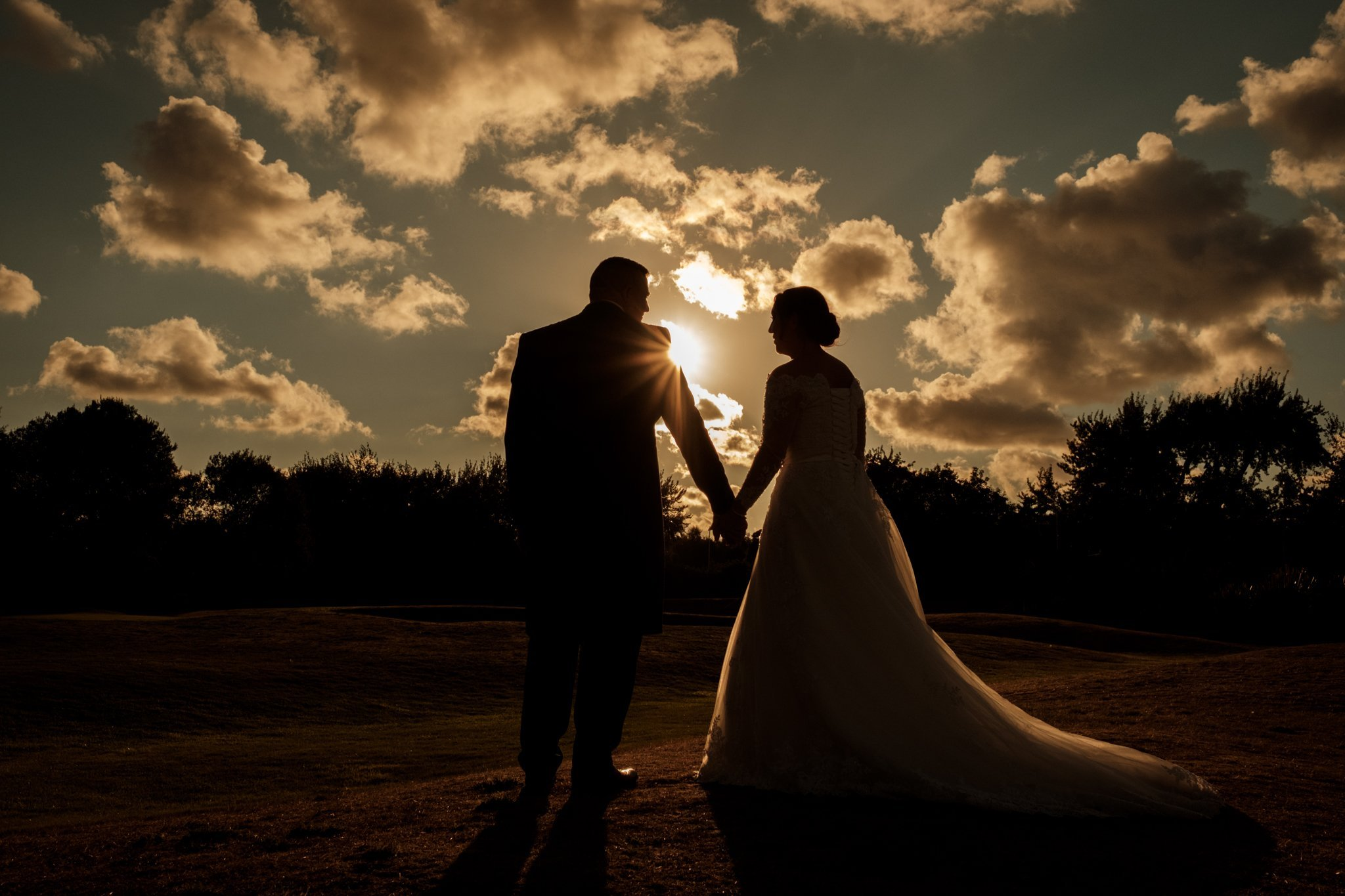 bride and groom during the sun set