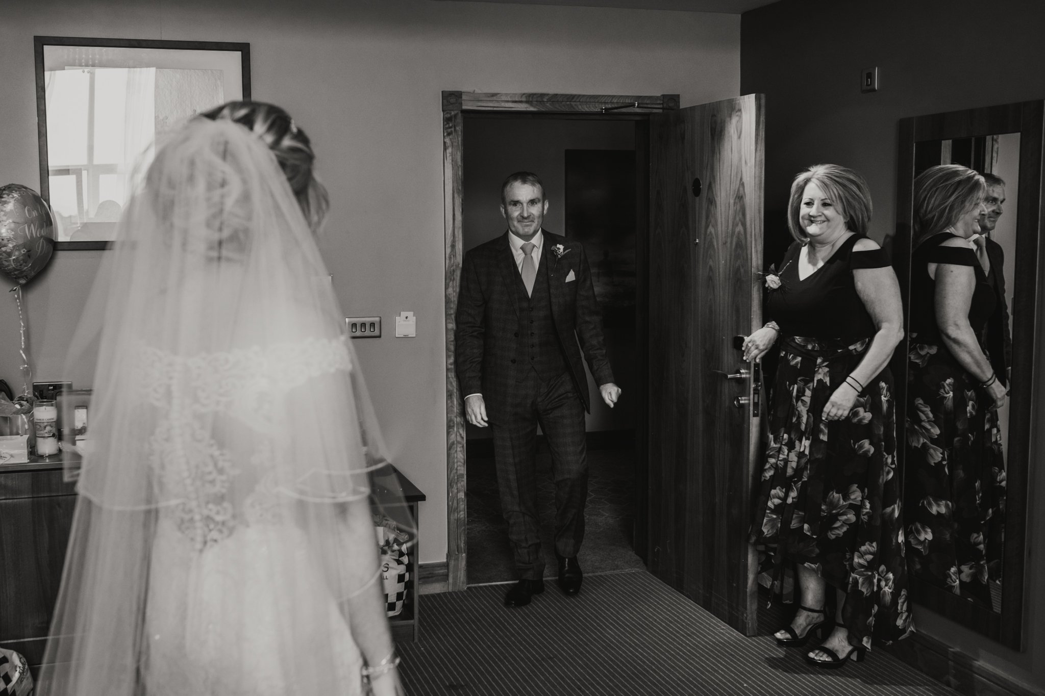 Father of the bride first look in the hotel room