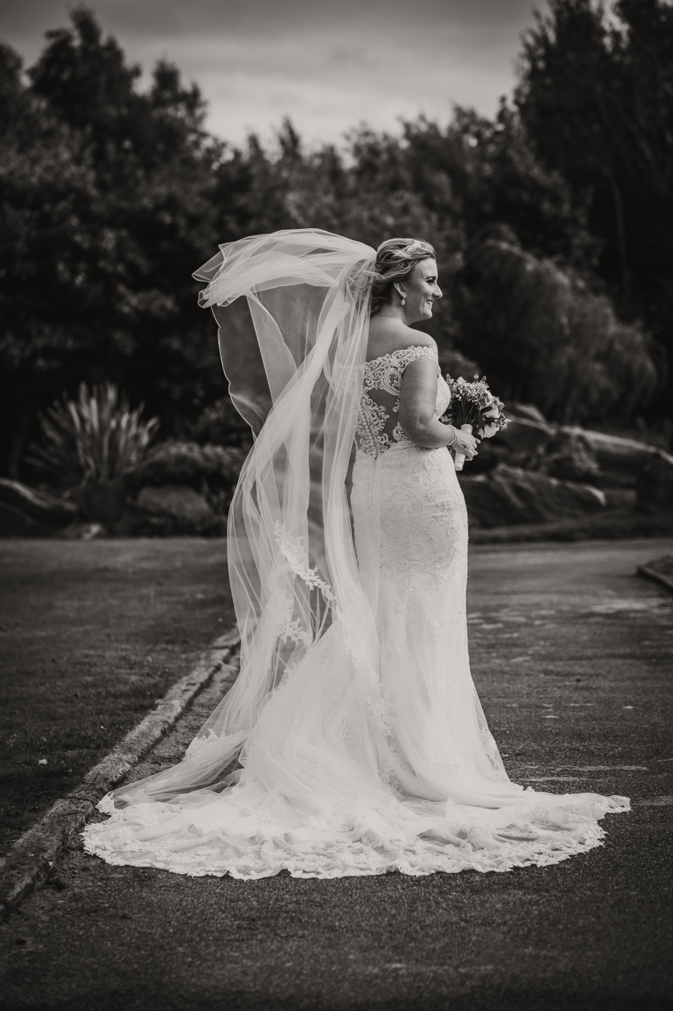 bride on her own with wind blowing her veil