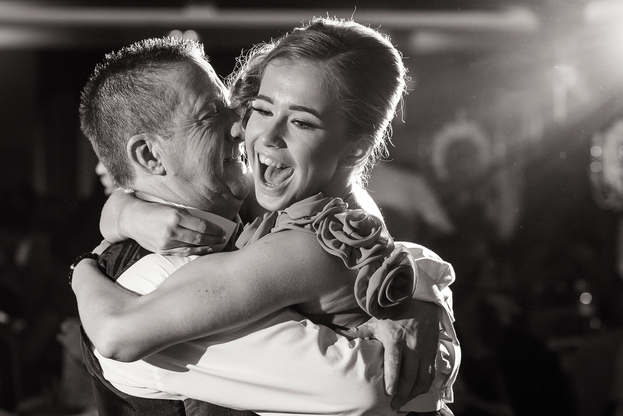 Father and young daughter hugging it out on the dance floor