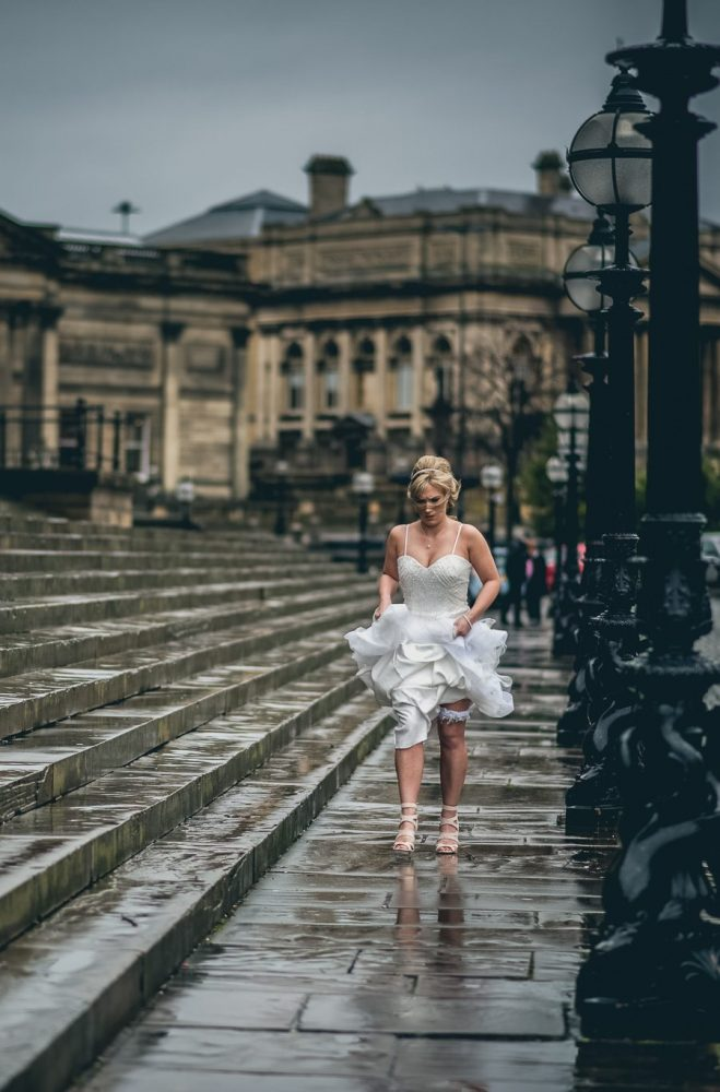 bride running in the rain