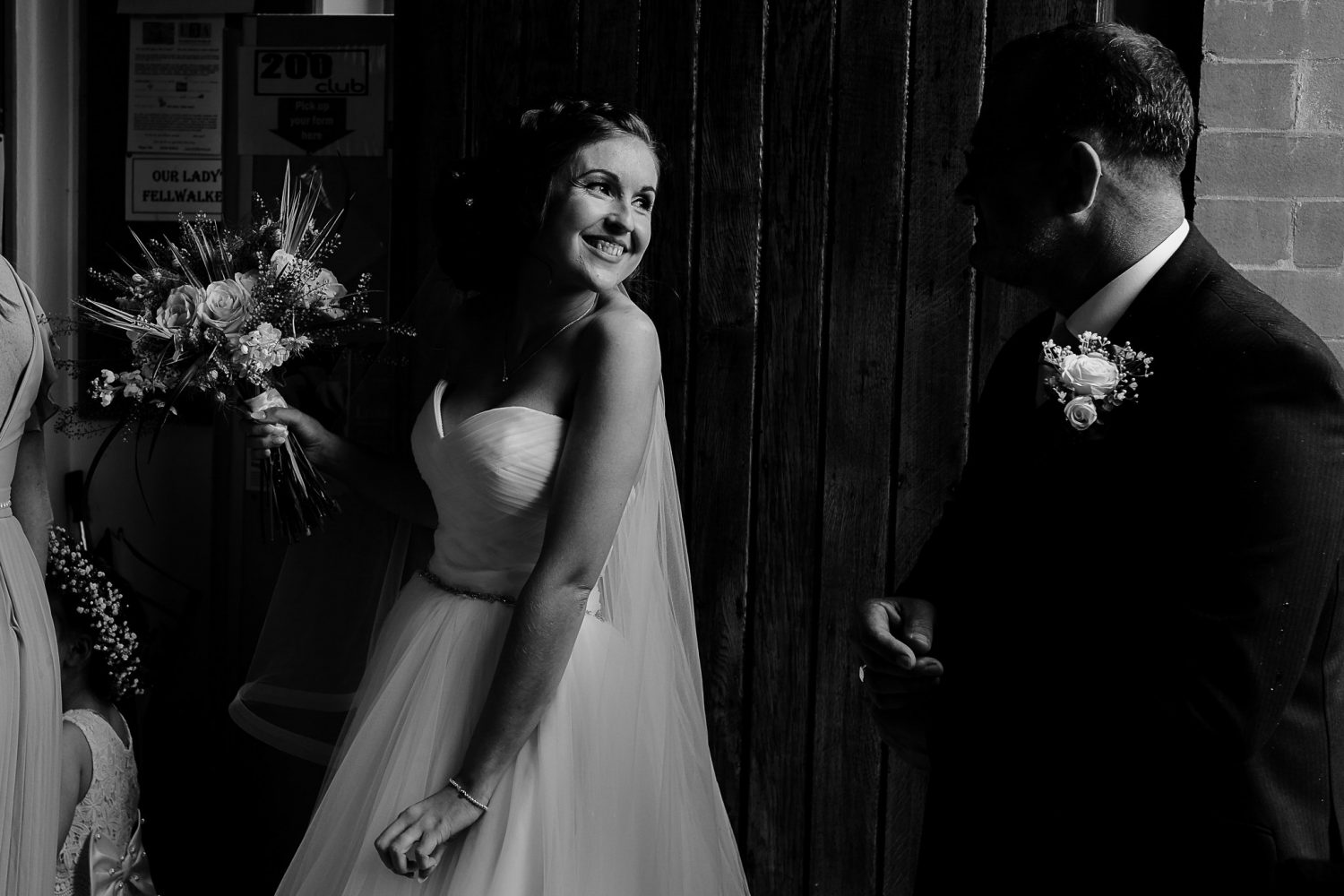 bride walking in to the church with her father documented by Liverpool wedding photographer Gavin Alexander