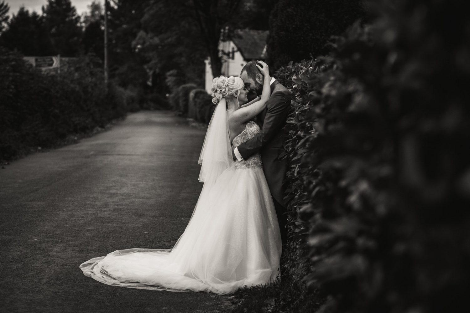 bride and groom in an embrace enjoying a cuddle
