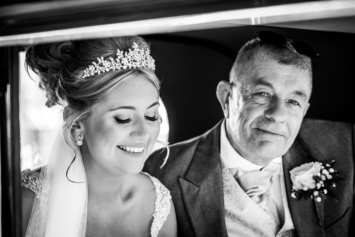 proud father in the wedding car with the bride