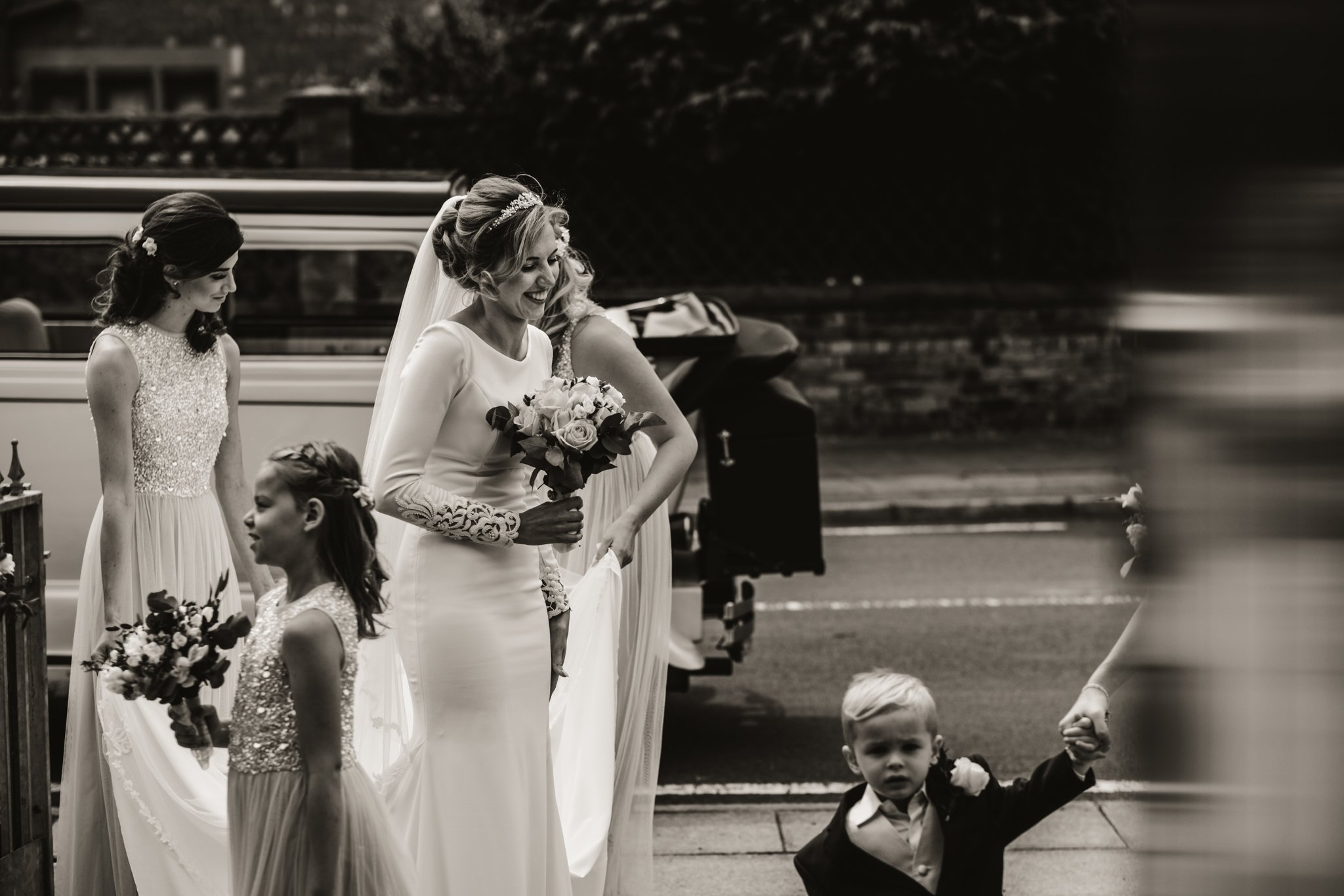 bride arriving at the church with her bridesmaids captured by West Tower wedding photographer Gavin Alexander