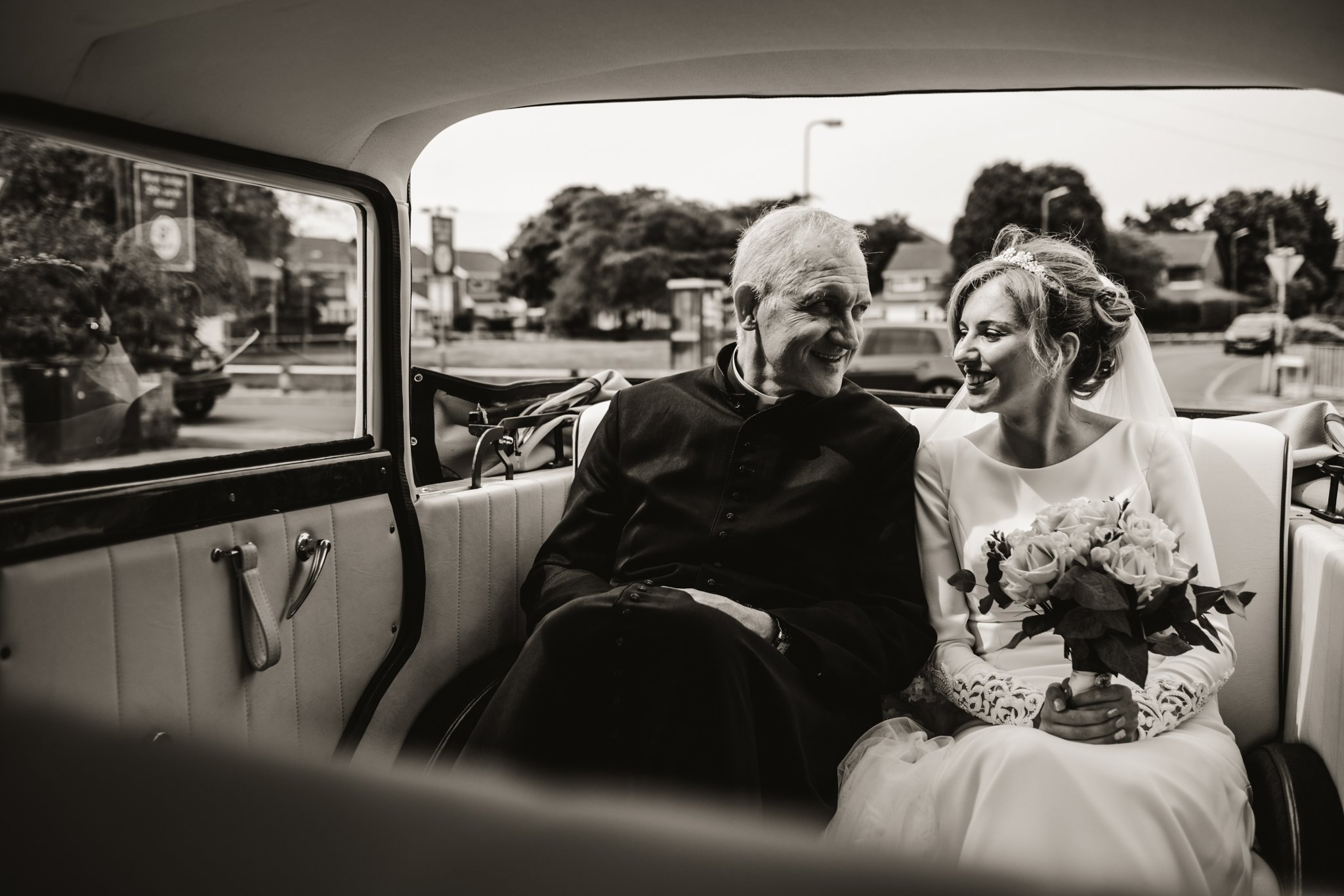 bride in the wedding car with her dad captured by West Tower wedding photographer Gavin Alexander