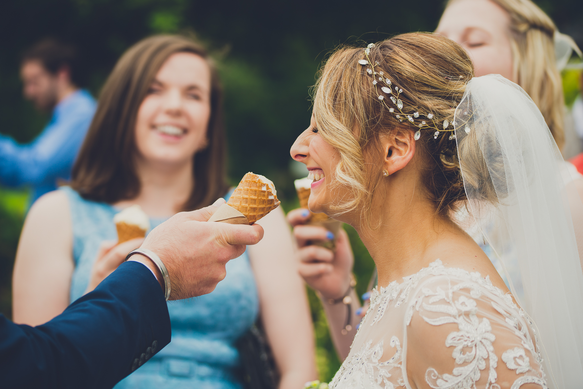 bride enjoying ice cream on the lawn at rookery hall cheshire