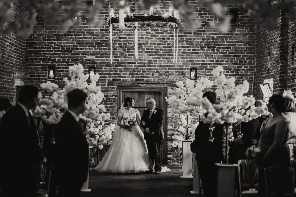 father walking his daughter down the aisle at Meols Hall wedding venue
