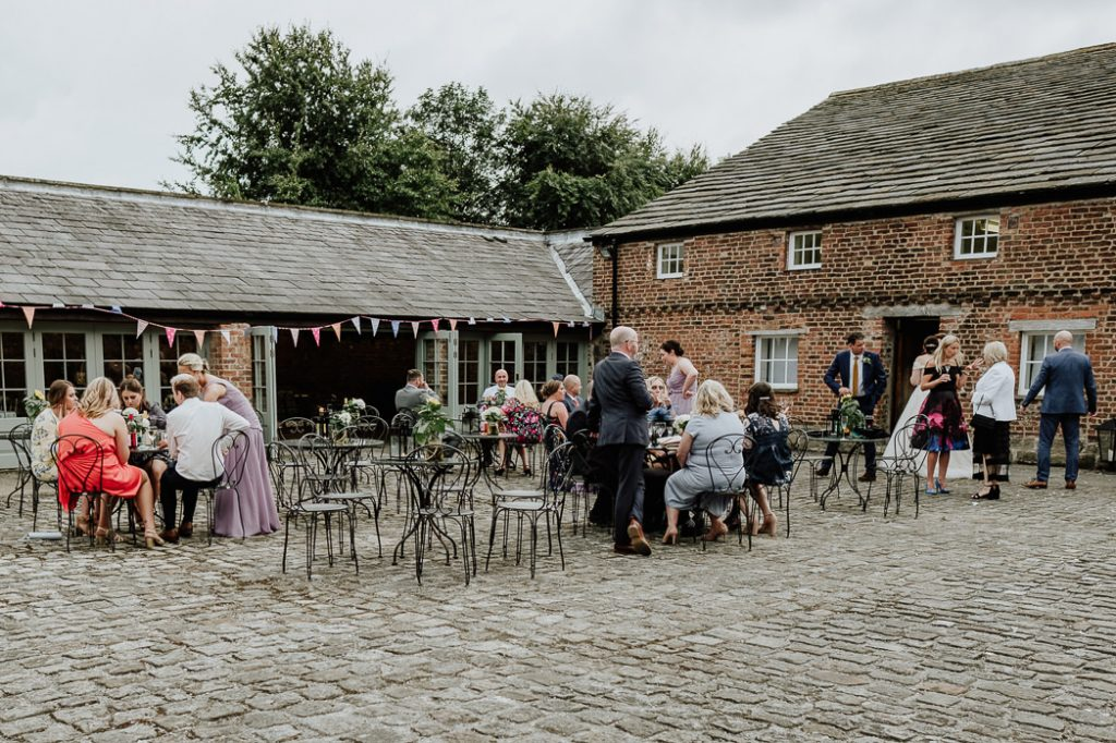 wedding guests enjoying themselves on the grounds of Meols Hall