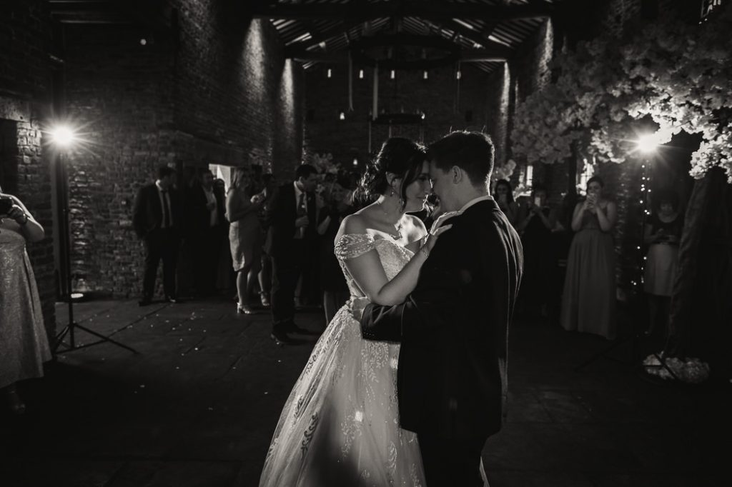 bride and groom dancing for their first dance