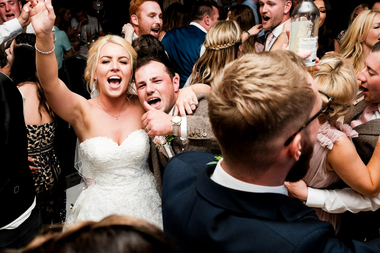 bride and groom dancing with their wedding guests